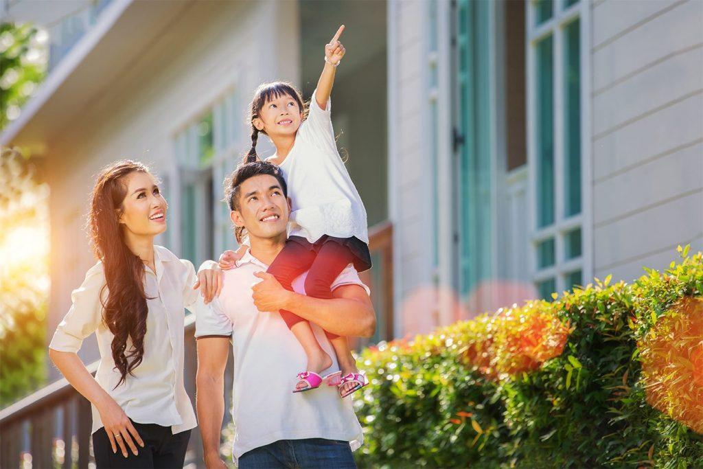 Asian Family smiling enjoying new home